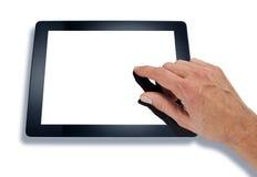 Рука используя таблетку компьютера стоковая фотография