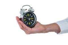 Рука исполнительного держа будильника Стоковые Изображения RF