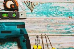 Рука и электрический комплект инструментов работы Стоковое Изображение