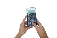 Рука коммерсантки используя калькулятор Стоковая Фотография