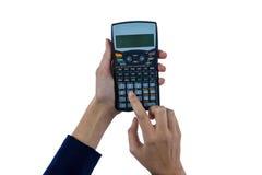 Рука коммерсантки используя калькулятор Стоковое Изображение RF