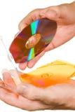 рука компактного диска коробки стоковое фото