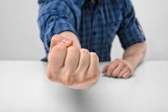 Рука конца-вверх человека показывает сжатый кулак Стоковые Изображения