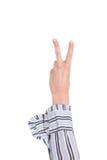 рука крупного плана рукоятки делая знак номера 2 Стоковые Изображения RF