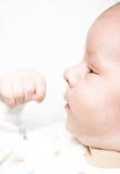 рука младенца его смотрит Стоковое Фото