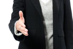 Рука молодой женщины предлагая для рукопожатия Стоковое Изображение RF