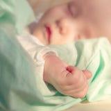 рука младенца немногая Стоковое Изображение