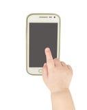Рука младенца указывая белый умный телефон Стоковое Изображение