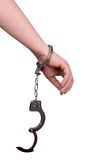 рука надевает наручники одно Стоковые Изображения