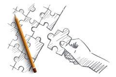 Рука нарисованная рукой человеческая завершая головоломку Стоковое фото RF