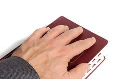 Рука на книге стоковое фото rf