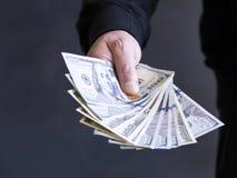 Рука на наличных деньгах Финансы развращение Противозаконные сделки стоковые изображения rf