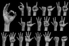 Рука на черно- номере и поет собрание Стоковое Изображение