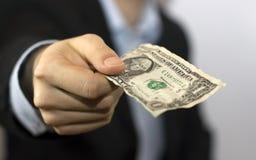 рука одно доллара счета Стоковая Фотография