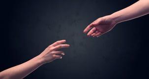 Рука около для того чтобы касаться другое одному Стоковое фото RF
