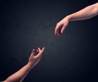 Рука около для того чтобы касаться другое одному Стоковые Фото