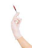 Рука доктора с шприцем Стоковая Фотография