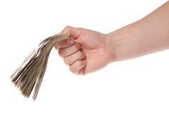 рука доллара кредиток держит 100 пакетов Стоковая Фотография RF