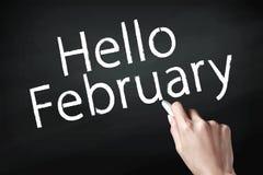 Рука писать февраль стоковая фотография