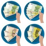 Рука показывая деньги Стоковая Фотография