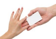 Рука поставляет карточку Стоковые Изображения RF