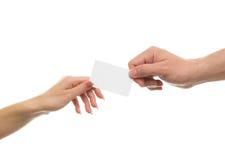 Рука поставляет карточку Стоковая Фотография