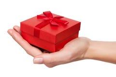 Рука при изолированный подарок стоковые изображения rf