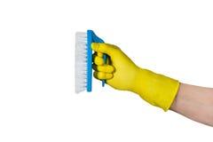 Рука при щетка чистки изолированная на белой предпосылке Стоковая Фотография