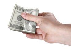 Рука проходя валюшку наличных денег Стоковые Фото