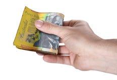 Рука проходя валюшку наличных денег Стоковая Фотография