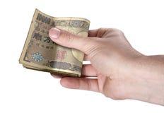 Рука проходя валюшку наличных денег Стоковое фото RF