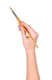 Рука рисует щетку на стоковые фотографии rf