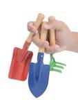рука сада держа 3 инструмента Стоковое Изображение RF