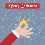 Рука Санты с звездой Предпосылка рождества с лентой приветствию бесплатная иллюстрация