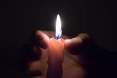 рука свечки Стоковая Фотография