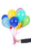 Рука с воздушными шарами стоковые изображения rf