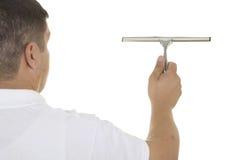 Рука с инструментом чистки окна Стоковое фото RF