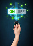 Рука с дистанционным управлением и включеный-выключеными сигналами Стоковые Изображения RF