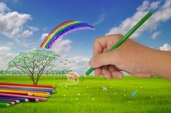Рука с картиной карандаша Стоковая Фотография
