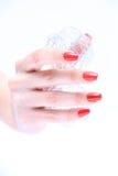 Рука с красным цветом ногтя Стоковые Фотографии RF
