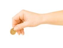 Рука с монеткой стоковое изображение rf