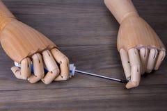 Рука с отверткой Стоковые Фото