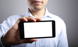 Рука с пустым умным телефоном стоковые изображения rf