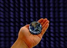 Рука с планетой Стоковая Фотография