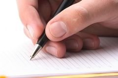 Рука с ручкой, ежедневный журнал, документ стоковое фото
