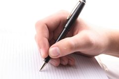 Рука с ручкой, ежедневный журнал, документ стоковые фотографии rf