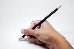 Рука с стирать карандаша Стоковая Фотография RF