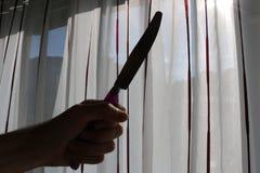 Рука с формой ножа Стоковые Фото