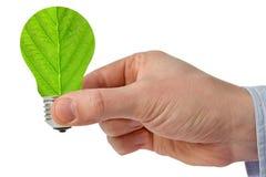 Рука с электрической лампочкой энергии зеленого цвета eco Стоковые Изображения RF
