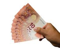 Рука с 10 banconotes евро Стоковая Фотография RF